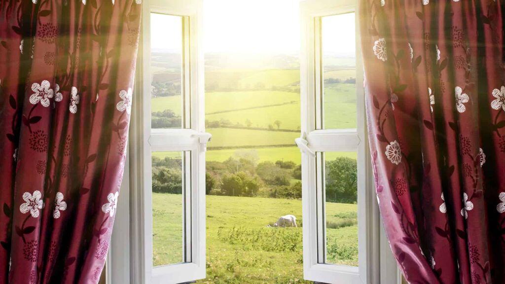 window looking into field