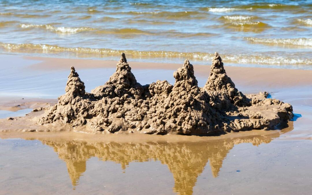 sand castle in waves